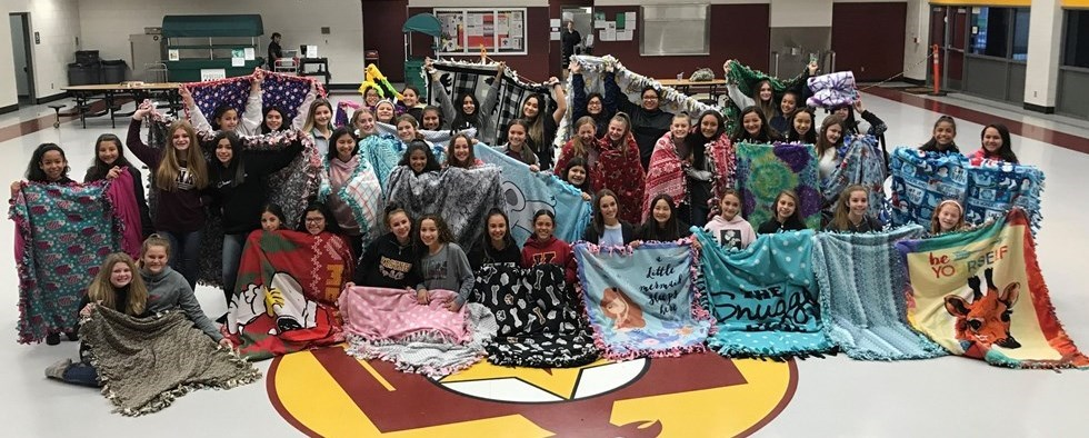 cheerleaders with their blankets