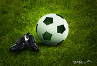 picture of soccer ball and cleats