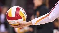volleyball in a persons hand